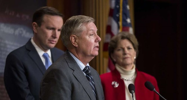 Sen. Lindsey Graham (C) speaks during a news conference about a resolution to end U.S. military support for Saudi Arabia's war with Yemen, Dec. 12, Washington.