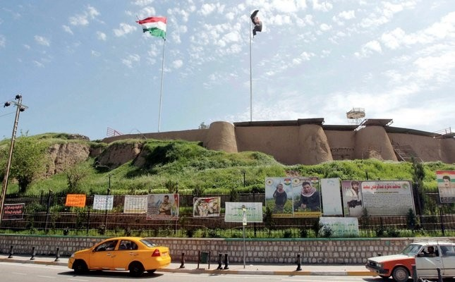 The Kurdish flag and the Iraqi flag are seen on a building in Kirkuk, Iraq, April 6