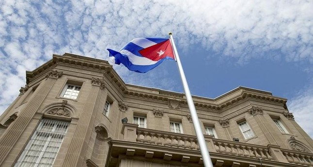 The Cuban national flag is seen raised over their embassy in Washington, July 20, 2015. (Reuters Photo)