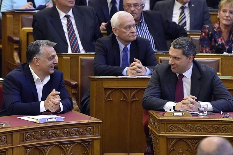 Hungarian Prime Minister Viktor Orban, left, and Head of the Prime Minister's Office Janos Lazar, right, during the debate of the proposal of modifying rules regulating foreign universities in Hungary at the Parliament in Budapest (AP Photo)