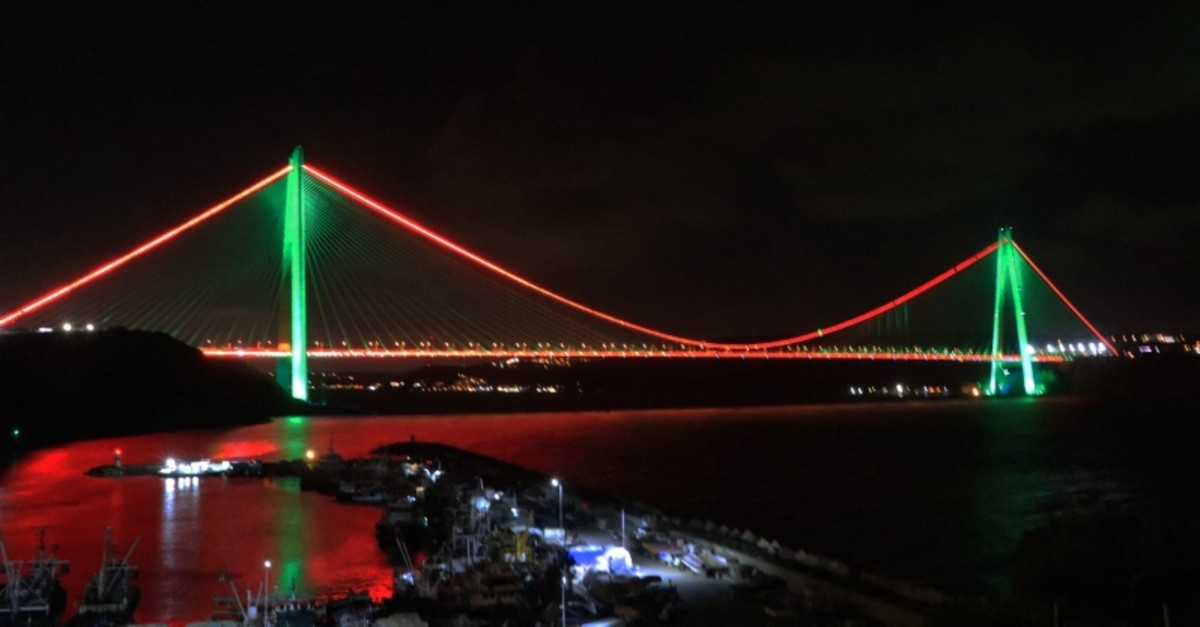 The Yavuz Sultan Selim Bridge is illuminated in Afghan flag's colors of green and red to mark the centennial of the country, on Aug. 20, 2019. (AA Photo)