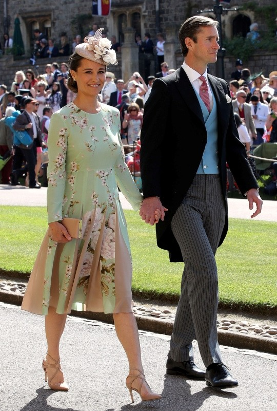 Pippa Middleton and James Matthews arrive for the wedding ceremony of Britain's Prince Harry, Duke of Sussex and US actress Meghan Markle at St George's Chapel, Windsor Castle, in Windsor, on May 19, 2018.