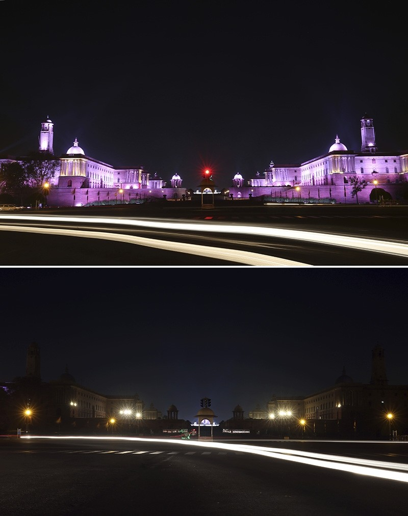 In this two photo combination picture, buildings that house India's seat of power are seen lit, top, and then the same location in darkness when the lights are turned out for one hour to mark Earth Hour, in New Delhi, India, Saturday, March 24, 2018 (AP Photo)