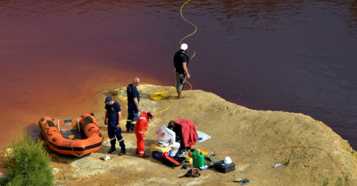 Forensics officers search Kokkinopezoula lake, also known as ,red lake,, for possible bodies of victims of a suspected serial killer near the village of Mitsero, Cyprus. (Reuters Photo)