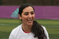 Afghan woman football star helps street kids score World Cup goal