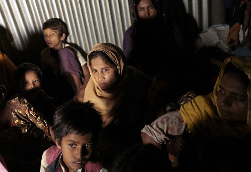 In this Dec. 2, 2016 file photo, Rohingya from Myanmar who recently crossed over to Bangladesh huddle in a room at an unregistered refugee camp. (AP Photo)