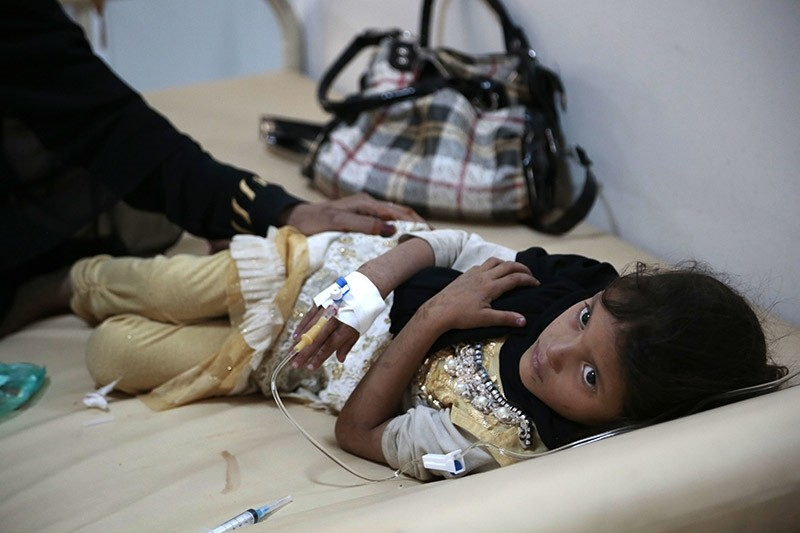 In this Saturday, July 1, 2017 file photo, a girl is treated for a suspected cholera infection at a hospital in Sanaa, Yemen. (AP Photo)