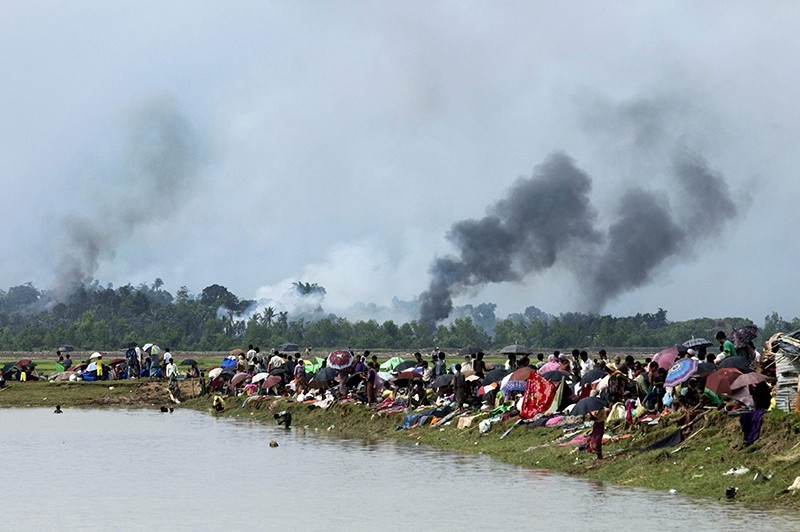 Smoke billows above a burning Rohingya village in Myanmar's Rakhine state as members of the Muslim minority take shelter in a no-man's land between Bangladesh and Myanmar in Ukhiya, Sept. 4, 2017. (AFP Photo)