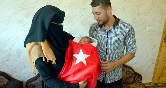 مولودان في غزة باسم أردوغان ابتهاجاً بفشل الانقلاب العسكري
