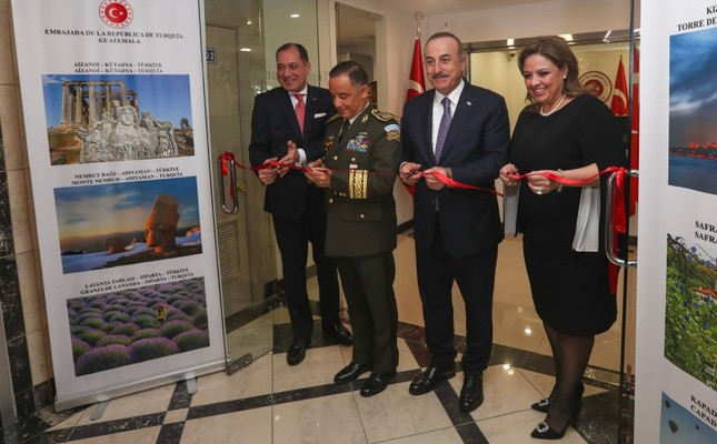 (L-R) Guatemalan Defense Minister and Chief of General Staff Miguel Ralda, Turkish FM Mevlüt Çavuşoğlu and his Guatemalan counterpart Sandra Jovel attend the inauguration ceremony for the new Turkish embassy building, on May 20, 2019. (AA Photo)