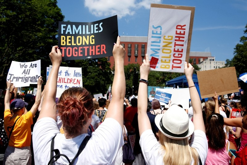 Immigration activists hold signs against family separation during a rally to protest against the Trump Administration's immigration policy outside the White House in Washington, U.S., June 30, 2018. (Reuters Photo)