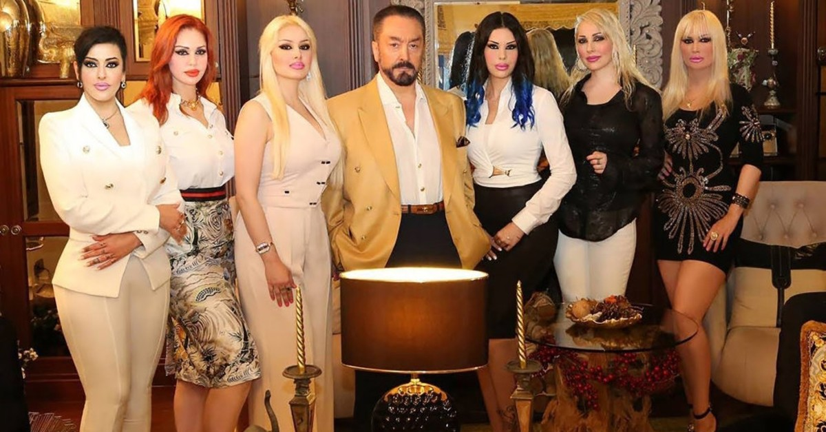 Adnan Oktar, center, is known for surrounding himself with surgically enhanced women allegedly brainwashed into joining his group.