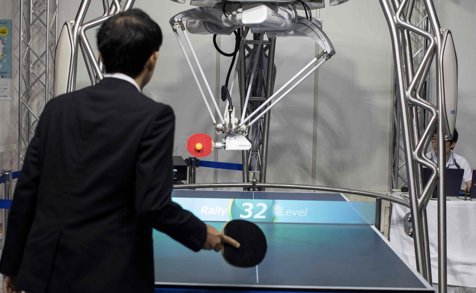 A table tennis robot developed by automation parts maker Omron returns a shot to a human player at the World Robot Summit in Tokyo, Oct. 18.