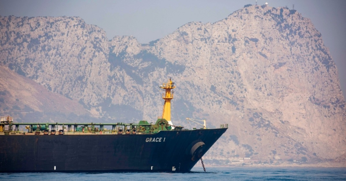 A view of the Grace 1 supertanker is seen backdropped by Gibraltar's Rock, as it stands at anchor in the British territory of Gibraltar, Thursday, Aug. 15, 2019, seized last month in a British Royal Navy operation off Gibraltar. (AP Photo)