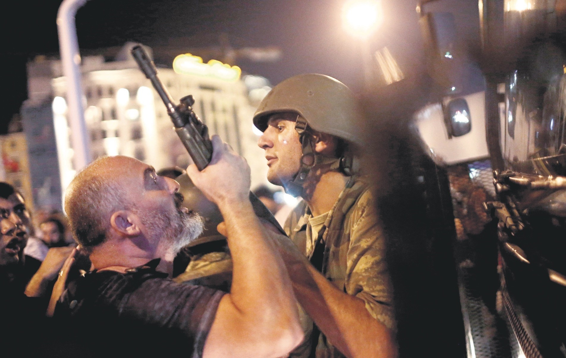 A civilian tries to take the rifle of a soldier at Istanbulu2019s Taksim Square. This act of resistance was just one of the many that became a symbol of the people's defense of democracy against the coup attempt.