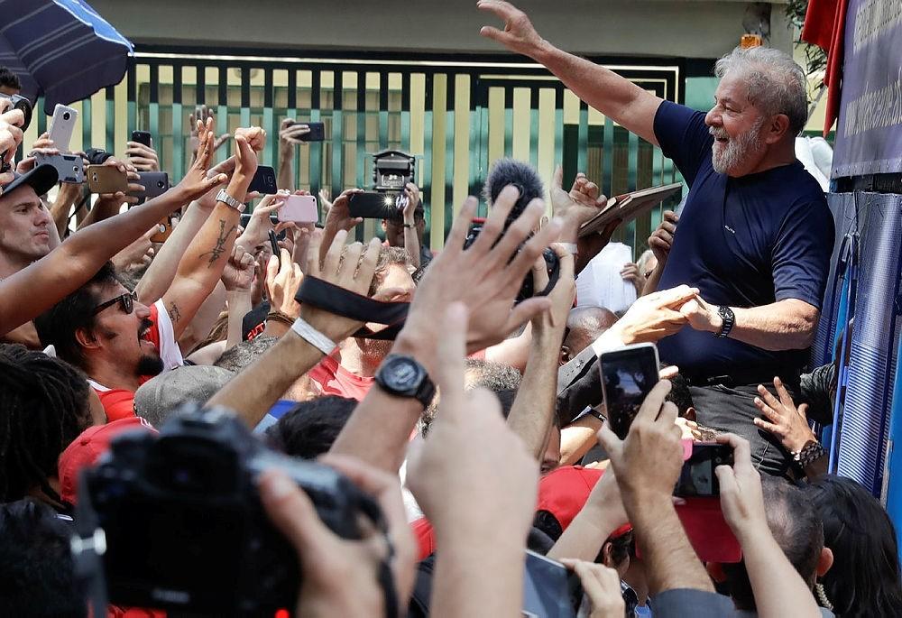 Brazilian former President Luiz Inacio Lula da Silva is carried aloft by supporters outside the Metal Workers Union headquarters in Sao Bernardo do Campo, Brazil, Saturday, April 7, 2018. (AP Photo)