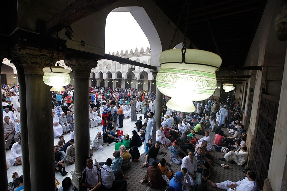 Egyptian Muslims gather to pray Eid al-Fitr prayers at Al-Azhar mosque