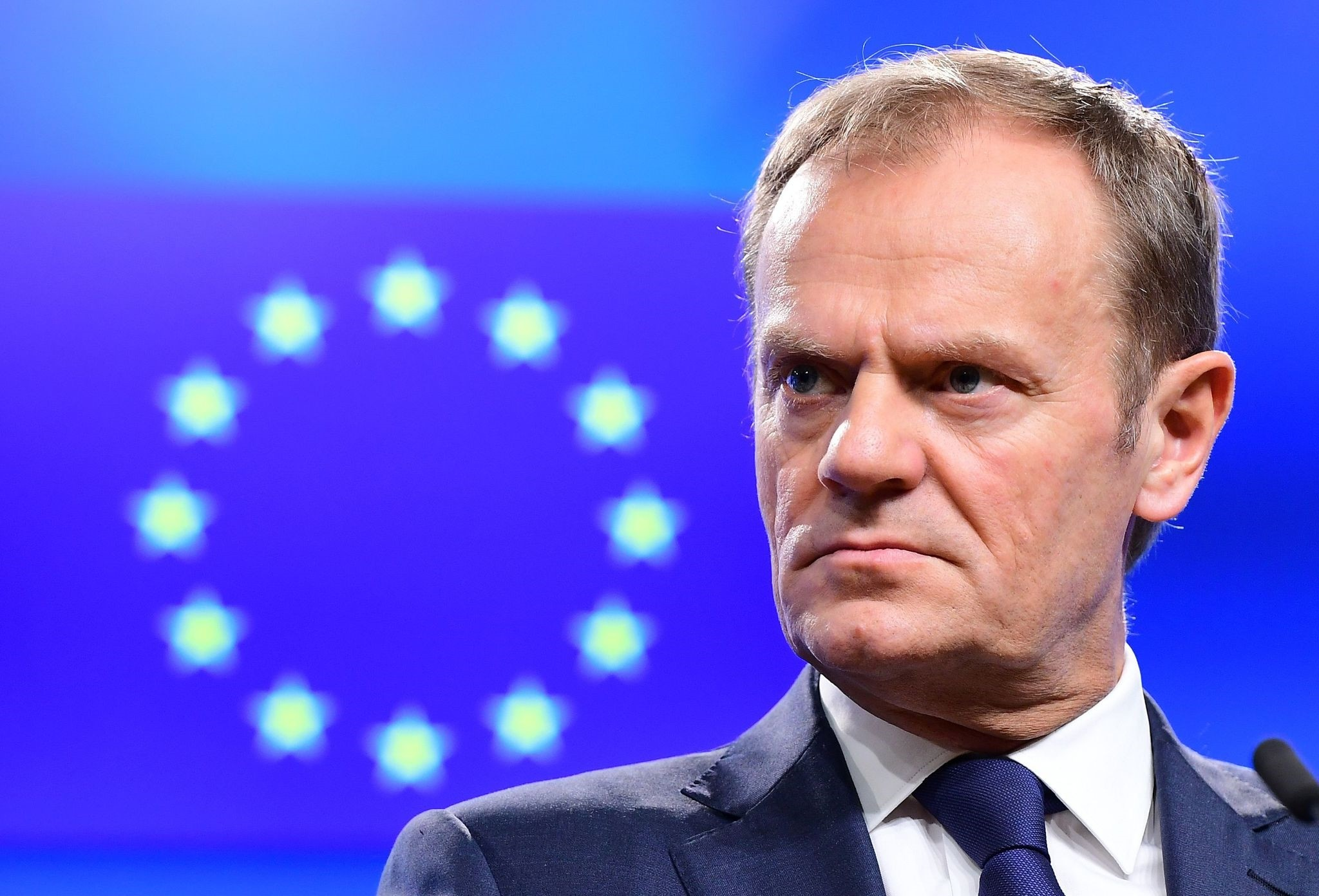 European Council President Donald Tusk reacts during a press statement announcing that an EU leaders' summit will take place to decide objectives for Brexit talks, March 21, 2017. (AFP Photo)