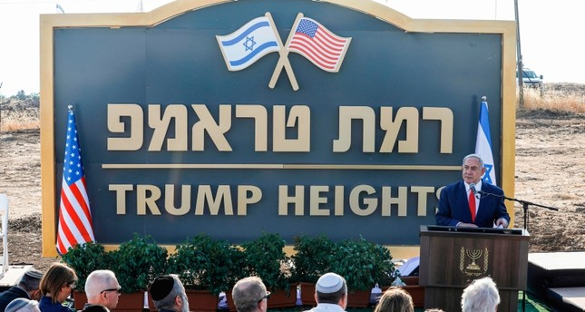 """Israeli PM Benjamin Netanyahu gives a speech before the newly-unveiled sign for the new settlement of Trump Heights,"""" named after U.S. President Donald Trump, during an official ceremony in the Israeli-annexed Golan Heights on June 16, 2019. (AFP)"""