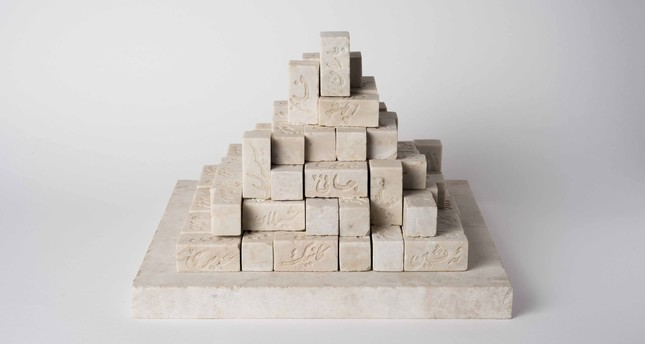 "In ""Monument to the Ordinaries II,"" Walid Siti's marble staircase bears Arabic words inscribed on its surface."