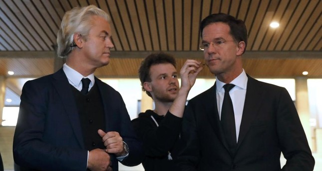 Geert Wilders of the PVV and Dutch PM Rutte R of the VVD take part in the debate in Rotterdam, on Monday.