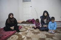 A Syrian mother holds onto life in Turkey after losing 27 relatives to civil war