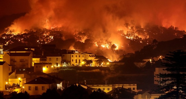 A forest fire burns on a hill in Monchique, Portugal, Aug. 5, 2018. (EPA Photo)