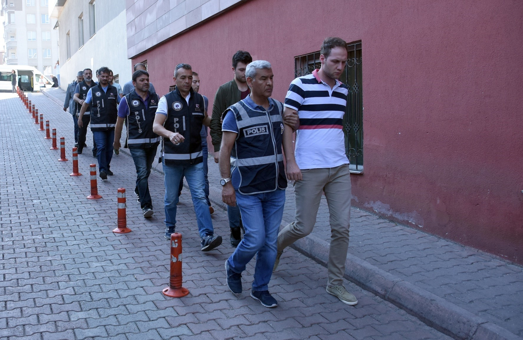 Police escort former military officers linked to FETu00d6 to courthouse in central city of Kayseri. The terrorist group faces almost daily operations after the 2016 coup attempt it is blamed for.