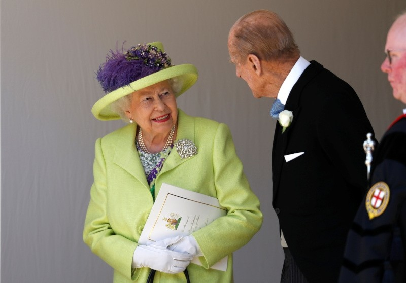 Britain's Queen Elizabeth talks with Prince Philip after the wedding ceremony of Prince Harry and Meghan Markle at St. George's Chapel in Windsor Castle in Windsor, near London, England, Saturday, May 19, 2018.