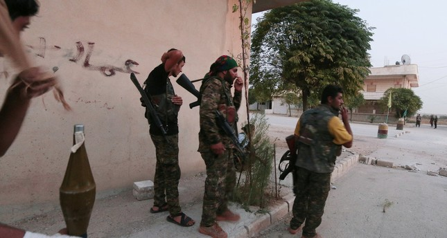 YPG fighters carry their weapons as they take positions in the northeastern city of Hasaka, Syria, August 20, 2016. (Reuters Photo)