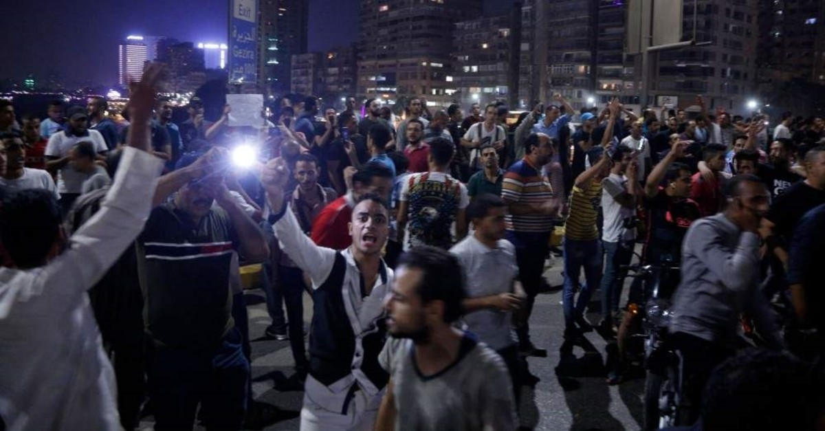 Egyptian protesters shout slogans as they take part in a protest calling for the removal of President Abdel-Fattah el-Sissi, Cairo, Sept. 20, 2019. (AFP Photo)