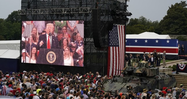 People watch on a giant screen as U.S. President Donald Trump speaks at the Salute to America event at the Lincoln Memorial during Fourth of July Independence Day celebrations, Washington, July 4, 2019.