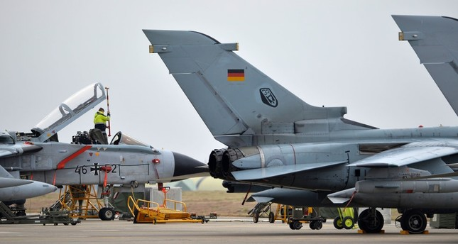A technician working on a German Tornado jet at the air base in İncirlik, Turkey on January 21, 2016.
