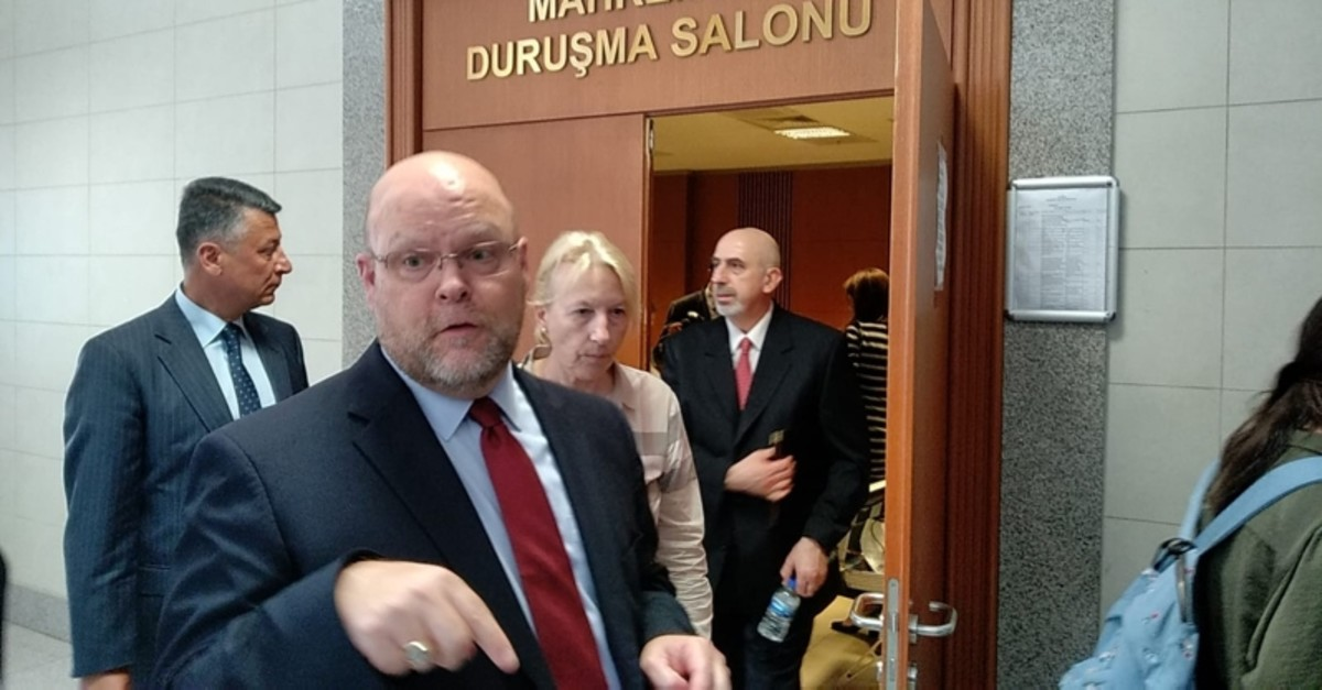 US Charge d'Affaires in Ankara Jeffrey Hovenier (L) speaks to reporters as US Istanbul Consulate Mete Cantu00fcrk, the suspect in trial over alleged links to FETu00d6, leaves the courtroom in Istanbul's u00c7au011flayan Courthouse. (DHA Photo)