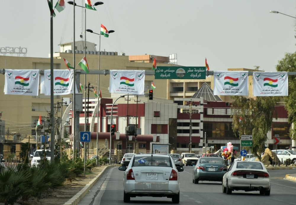 Posters encouraging people to vote in the KRG independence referendum are seen in central Kirkuk on Sept. 21.