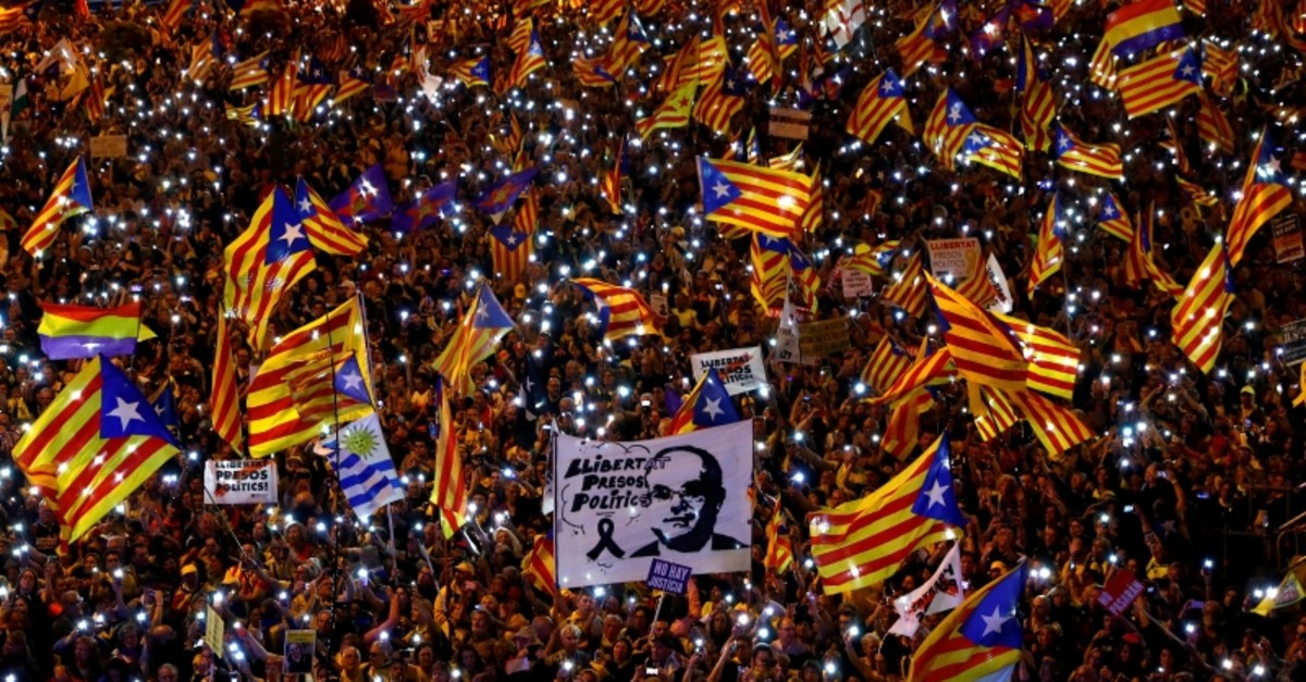 People take part in a rally of Catalan separatist organisations to demonstrate against the trial of Catalan leaders and call for self-determination rights, in Madrid, March 16, 2019. Banner reads ,Freedom for political prisoners., (Reuters Photo)