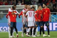 Spain snatches late draw with Morocco to reach World Cup knockout round