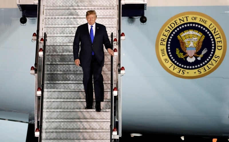 Trump steps off his plane as he arrives at Paya Lebar Air Base in Singapore, ahead of a summit with North Korean leader Kim Jong Un, June 10, 2018.  (REUTERS Photo)