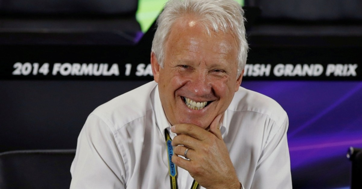 Federation Internationale de l'Automobile (FIA) race director Charlie Whiting laughs during a media question and answer session ahead of the British Grand Prix at the Silverstone race circuit, central England, July 3, 2014. (REUTERS Photo)