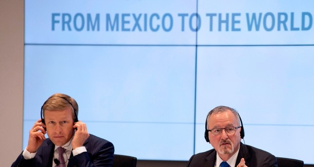 BMW AG's board of management member Oliver Zipse (L) and the vice-president of BMW Communications Strategy, Bill McAndrews, offer a press conference before the inauguration of a new BMW production plant, in San Luis Potosi, Mexico (AFP Photo)