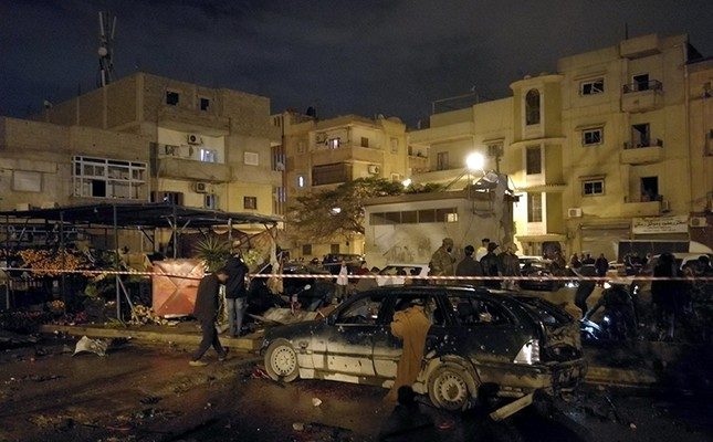 People gather at the site of twin car bombs in Benghazi, Libya, Jan. 23, 2018. (Reuters Photo)