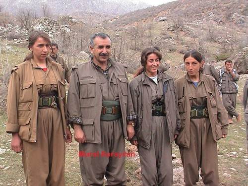 PKK leader Murat Karayılan stands next to female militants.