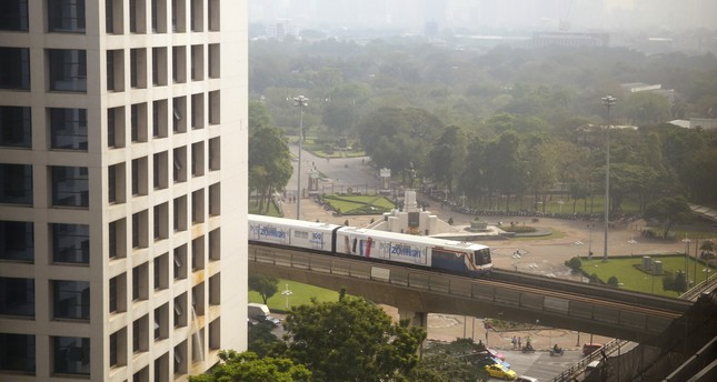 An elevated train passes in front of the Lumpini Park covered in a thick layer of smog downtown Bangkok, Thailand, early Thursday, Feb. 8, 2018. (AP Photo)