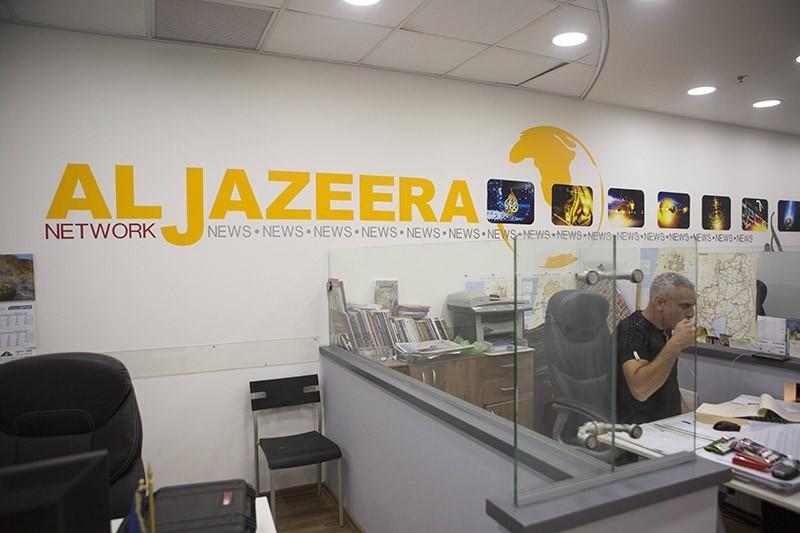 Employees of Ai-Jazeera satellite channel, work at their Jerusalem bureau, Israel, 14 June 2017. (EPA Photo)