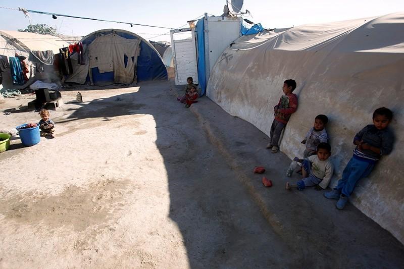 Displaced Iraqi children are seen at the Amriyat al Falluja camp in Anbar Province, Iraq (Reuters Photo)