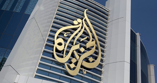The logo of Al Jazeera Media Network is seen on its headquarters building in Doha, Qatar June 8, 2017 (Reuters Photo)