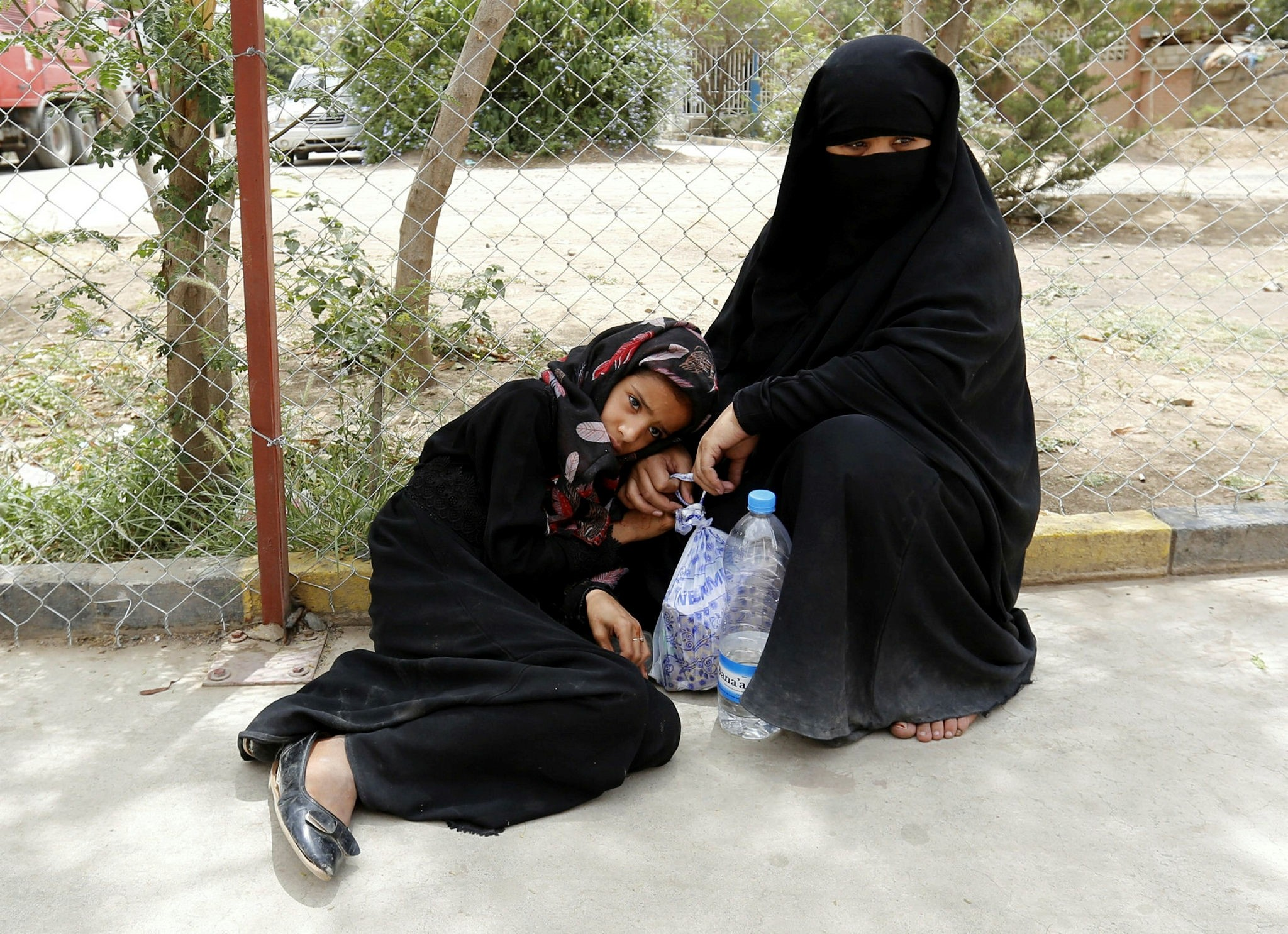 A cholera-infected Yemeni girl waits to receive treatment next to her mother at a hospital amid a serious cholera outbreak in Sanau2019a, Yemen, July 1.