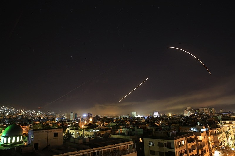 Missiles streak across the Damascus skyline as the U.S. launches an attack on Syria targeting different parts of the capital. (AP Photo)