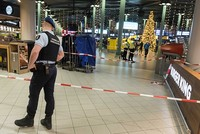 A knife-wielding man who was shot and wounded by Dutch military police after bursting into their office at Amsterdam's Schiphol airport was