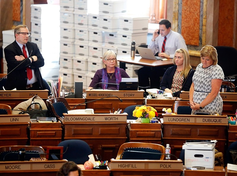 Rep. Brian Meyer of Polk County questions Representative Shannon Lundgren of Dubuque on the floor of the Iowa House as legislators debate the ,heartbeat, bill at the state capitol (AP Photo)